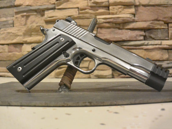 Polished Ruger 1911 .45 with tritium sights, grips, compensator and Cerakote paint.